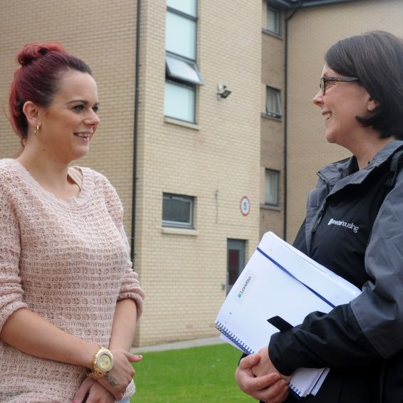 Housing Officer Claire Latto chats with a Loretto tenant